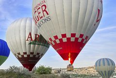 Hot air balloons flying over valley in the morning. Cappadocia. Turkey royalty free stock photography