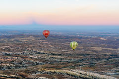 Hot air balloons flying over valley at sunrise. Cappadocia. Turkey Stock Photography