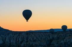 Hot air balloons flying over valley at sunrise. Cappadocia. Turkey Stock Photo