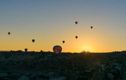 Hot air balloons flying over valley at sunrise. Cappadocia. Turkey Royalty Free Stock Photos