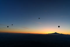 Hot air balloons flying over valley at sunrise. Cappadocia. Turkey Stock Image