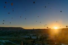 Hot air balloons flying over valley at sunrise. Cappadocia. Turkey Royalty Free Stock Image