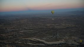 Hot air balloons flying over valley at sunrise. Cappadocia. Turkey stock video footage