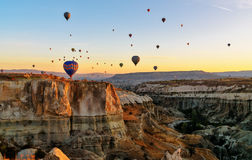 Hot air balloons flying over valley at sunrise. Cappadocia. Turkey Royalty Free Stock Image