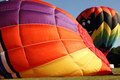 Hot Air Balloons getting inflated for flight. Royalty Free Stock Photography