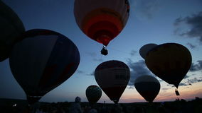 Hot air balloons glows in the dark sky. Hot air balloon in the dark sky stock video
