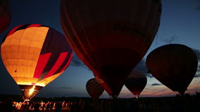 Hot air balloons glows in the dark sky. Hot air balloon in the dark sky, timelaps stock footage