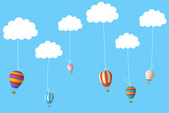 Hot air balloons hanging from clouds Stock Photos