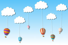Hot air balloons hanging from clouds Stock Image