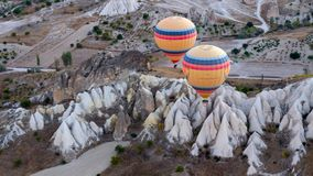Hot air balloons hovering over the volcanic  valley . Living- Museum, Cappadocia,Turkey, autumn stock photography