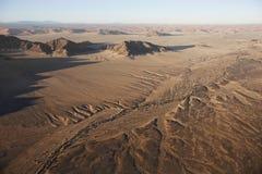 Hot air balloons landing on the sands of the Sossusvlei Desert, stock photo