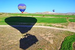 Hot air balloons landing in spring fields Cappadocia Turkey Royalty Free Stock Images
