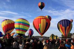Hot air balloons lift off Stock Photos