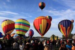 Hot air balloons lift off. September 2009 Atlantic International Balloon Fiesta, Sussex, New Brunswick, Canada. Ascension from Princess Louise Park Stock Photos