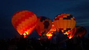 Hot air balloons. Lighting up the fire and stock image
