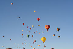 Hot air balloons line the sky Stock Photo