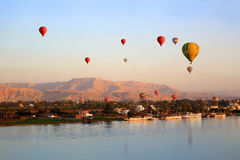 Hot air balloons in Luxor at sunrise Stock Images
