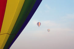 Hot air balloons in the morning fog Stock Photos