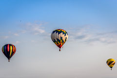 Hot Air Balloons - Multiple. Three hot air balloons in flight at Waterford, WI festival Royalty Free Stock Image