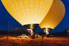 Hot air balloons near cars at night,. Cappadocia, Turkey royalty free stock photo