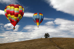 Hot Air Balloons Near a Hill Royalty Free Stock Photo