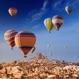 Hot air balloons near Uchisar castle Royalty Free Stock Image