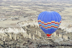 Hot air balloons negotiating a ravine Stock Photo