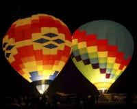 Hot air balloons at night. Two colorful hot air balloons illuminated at night royalty free stock photo