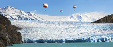 Hot air balloons over beautiful glacier Royalty Free Stock Photography