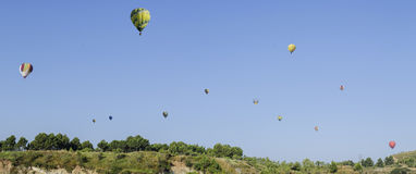 Hot air balloons over blue sky Royalty Free Stock Images