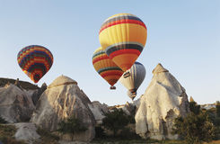 Hot Air Balloons Over Cappodocia Terrain Royalty Free Stock Photos
