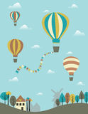 Hot air balloons. Over the country Stock Photos