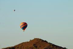 Hot Air Balloons over Desert Mountain Royalty Free Stock Photos