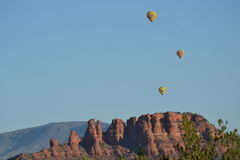 Hot air balloons over the desert red rocks of Sedo. Balloons fly over the Arizona desert near Sedona Stock Photo