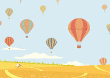 Hot air balloons over fields Stock Photo