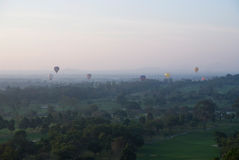 Hot air balloons over a golf course Royalty Free Stock Photo
