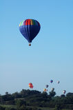 Hot air balloons over Iowa. A group of hot air balloons in flight over Iowa during a balloon festival stock photos