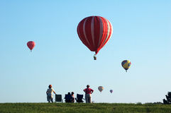 Hot air balloons over Iowa. A group of hot air balloons in flight over Iowa during a balloon festival royalty free stock photo