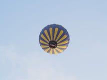 Hot air balloons over landscape at Cappadocia, Turkey. Hot air balloons flying over landscape at Cappadocia, Turkey Stock Photo