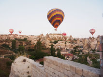 Hot air balloons over landscape at Cappadocia, Turkey, Goreme Stock Image