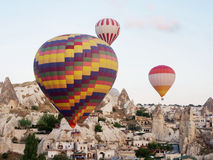 Hot air balloons over landscape at Cappadocia, Turkey, Goreme Stock Photo