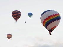 Hot air balloons over landscape at Cappadocia, Turkey, Goreme. Hot air balloons flying over landscape at Cappadocia, Turkey, Goreme Stock Photography