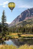 Hot Air Balloons over  Mountainous Landscape Stock Photography