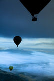 Hot Air Balloons Over Mountains Stock Photography