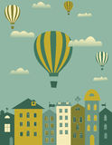 Hot air balloons over the town. Hot air balloons flying over the town Stock Photos