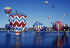 Hot Air Balloons over water Royalty Free Stock Photo