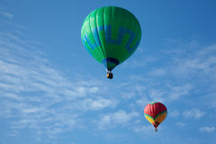 Hot air balloons with people fly. In the blue sky Royalty Free Stock Photos
