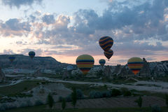 Hot air balloons rise over Cappadocia, Turkey Royalty Free Stock Photos