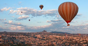 Hot air balloons rise over Cappadocia, Turkey Royalty Free Stock Photography