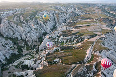 Hot air balloons rise over valley, Turkey Royalty Free Stock Images